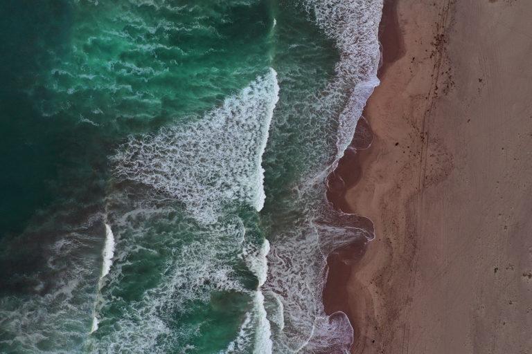 Waves breaking on a beach in California. Photo by Rhett A. Butler.