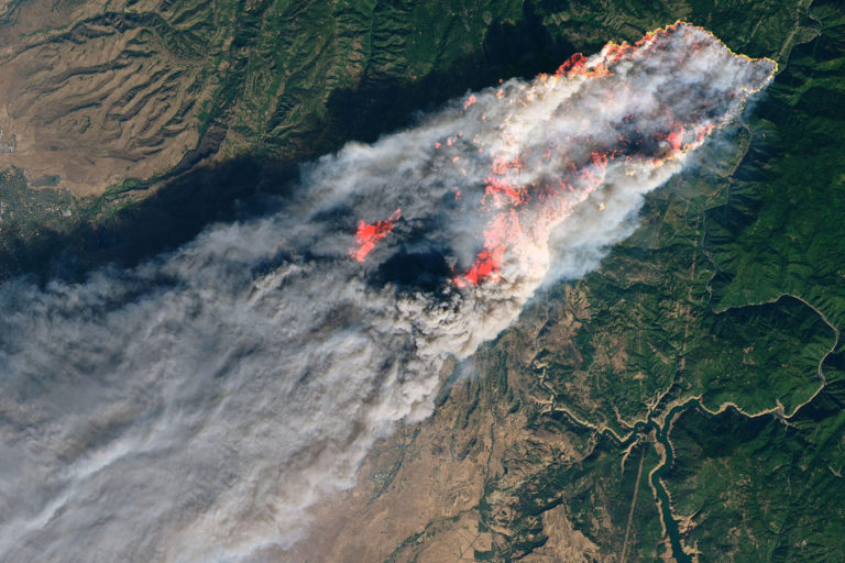 An image of California's Camp Fire on November 8, 2018 from NASA's Landsat 8 satellite. Photo credit: USGS/NASA/Joshua Stevens