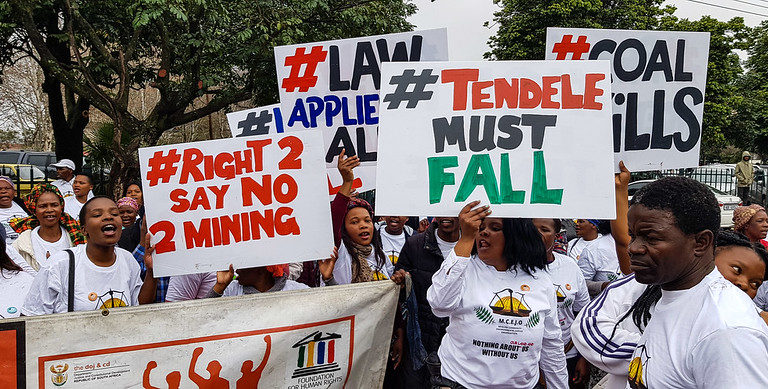 Protest against Tendele, 2018. Image by Rob Symon via Flickr (CC BY-NC-ND 2.0)