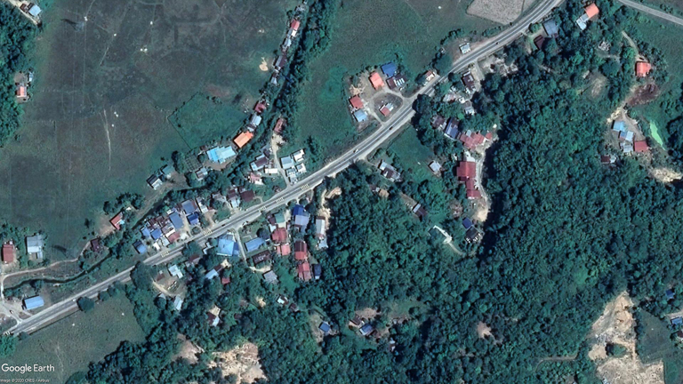 A Google Earth image shows the development crowding along existing roads in the Tuaran area of Sabah. Image courtesy of LEAP/Coalition 3H.