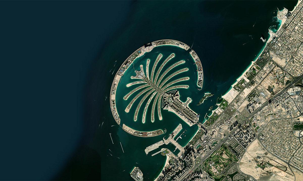 Palm Jumeriah, an artificial island, off the coast of Dubai. Photo credit: Zoom.Earth / Maxar Technologies