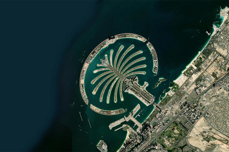Palm Jumeriah, an artificial island, off the coast of Dubai. Photo credit: Zoom.Earth / Maxar Technologies