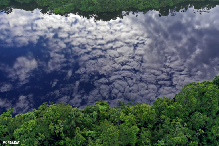Clouds reflected in a blackwater oxbow lake in the Peruvian Amazon.