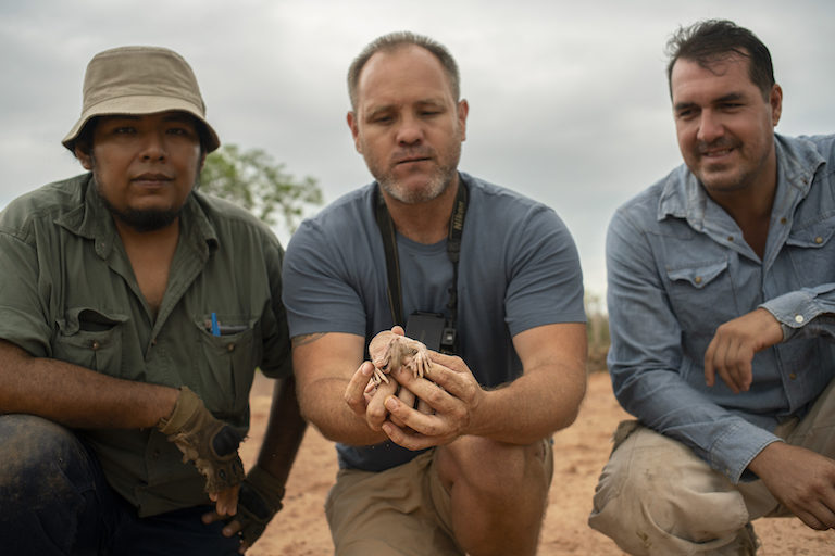 """Fits in the palm of your hand."" Huascar Bustillos Cayola, Nick Mcphee, and Milton Lopez, owner of the hacienda where the greater fairy armadillo was observed. Photo courtesy of Ivan Gutierrez Lemaitre."