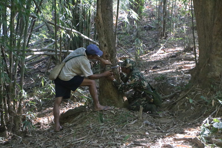 Community forest rangers logging data on patrol in the Salween Peace Park, Kayin state, Myanmar. Image courtesy of KESAN.