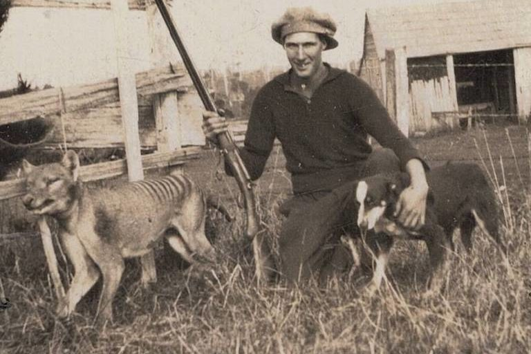 Wilfred Batty of Mawbanna, Tasmania, with the last thylacine known to have been shot in the wild. He claimed to have shot it in May, 1930, after discovering it in his hen house. Image in the public domain.