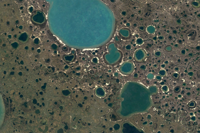 Water in craters formed by methane leaks from the permafrost on Russia's Yamal Peninsula in 2021. Photo credit: NASA Landsat / Copernicus
