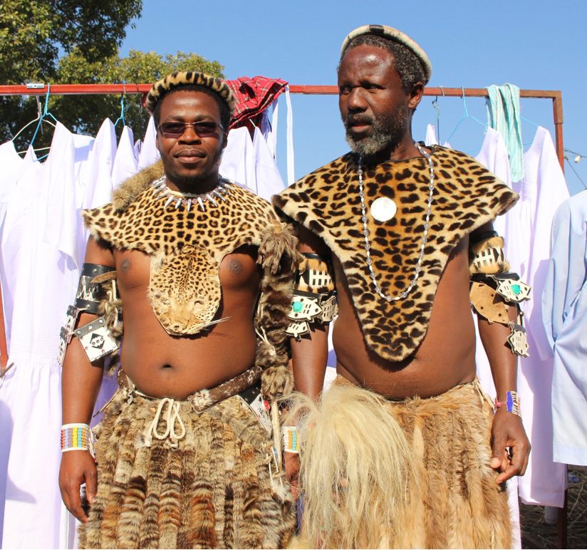 Members of the Shembe Church, one wearing a real leopard skin amambatha, left, and the other an artificial one. Image by Pippa Orpen.