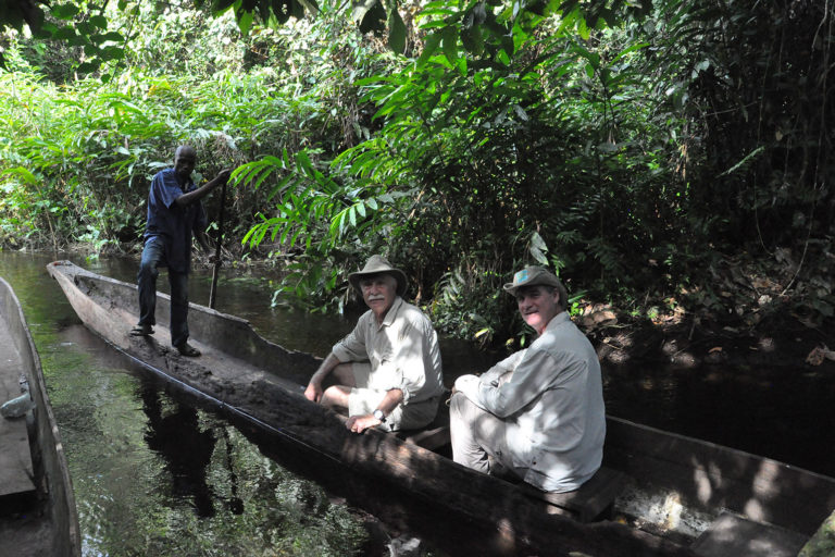 Rodger Schlickeisen and a colleague in a canoe in the Congo Basin.