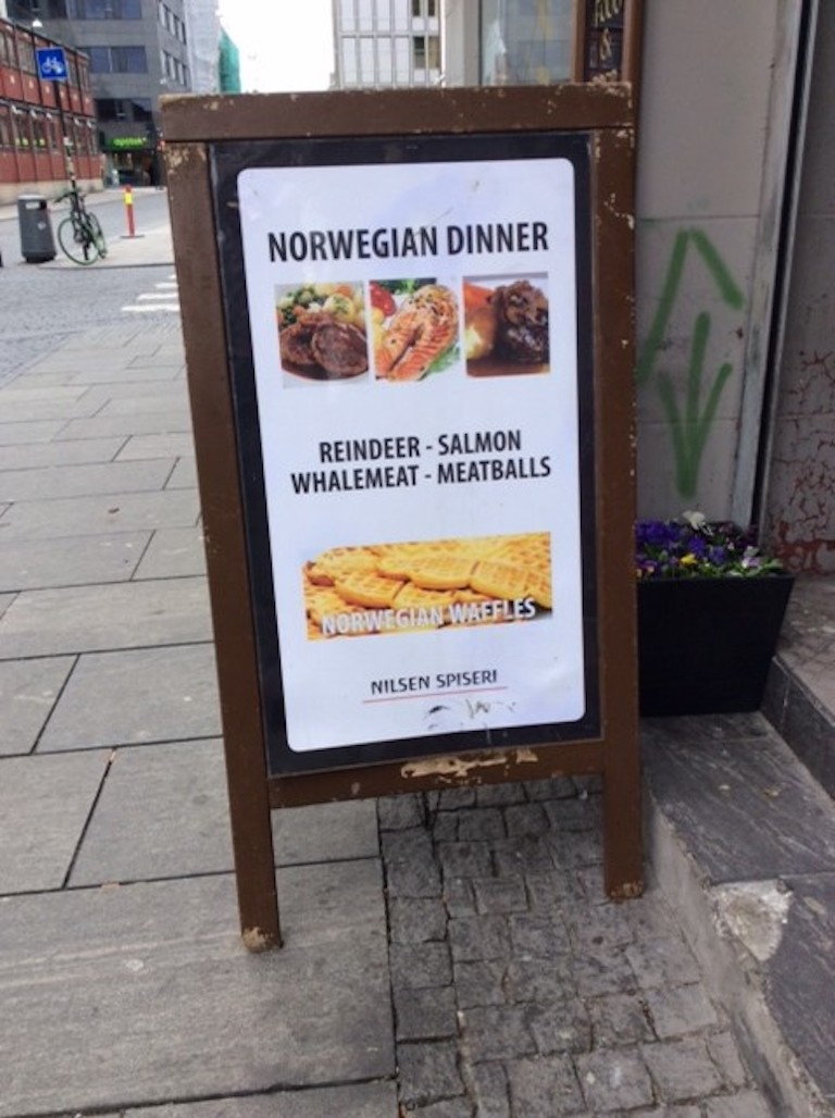 A sign advertising whale meat in Oslo, Norway. Image by Kate O'Connell / AWI.