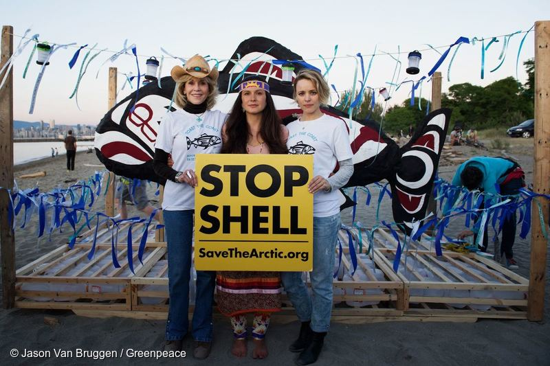 "Jane Fonda, Rachel McAdams and Melina Laboucan-Massimo hold a sign that reads ""Stop Shell, Save The Arctic"". Photo © Jason Van Bruggen / Greenpeace"