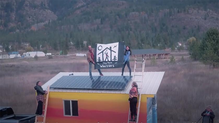 Installing solar panels. Photo credit: Sacred Earth Solar