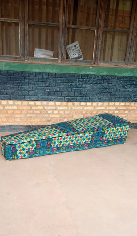 The coffin of Blaise Mokwe, a community member who allegedly died at the hands of plantation security guard. Image courtesy of the Oakland Institute.