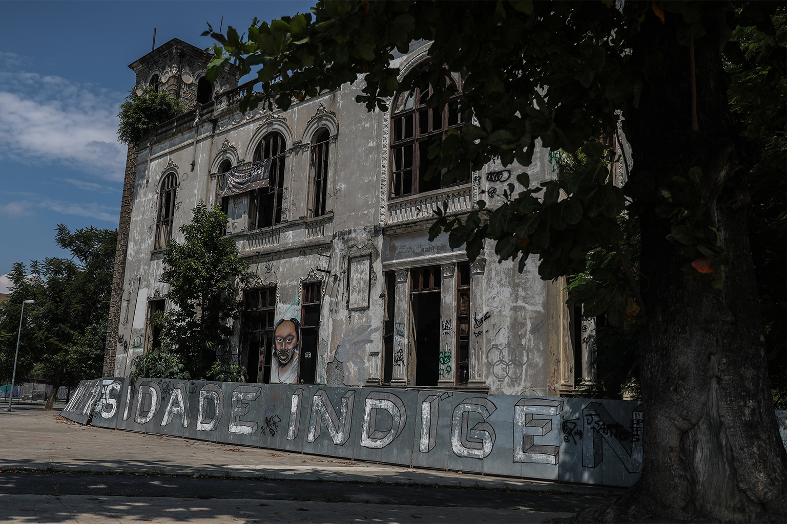 Image of building decorated with street art and graffiti.