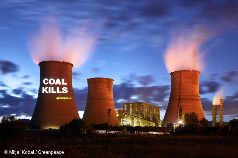 Activists project anti-coal messages on one of the cooling towers of the Bobov Dol power plant near the village of Golemo Selo, Bulgaria in 2018. Photo © Mitja Kobal / Greenpeace