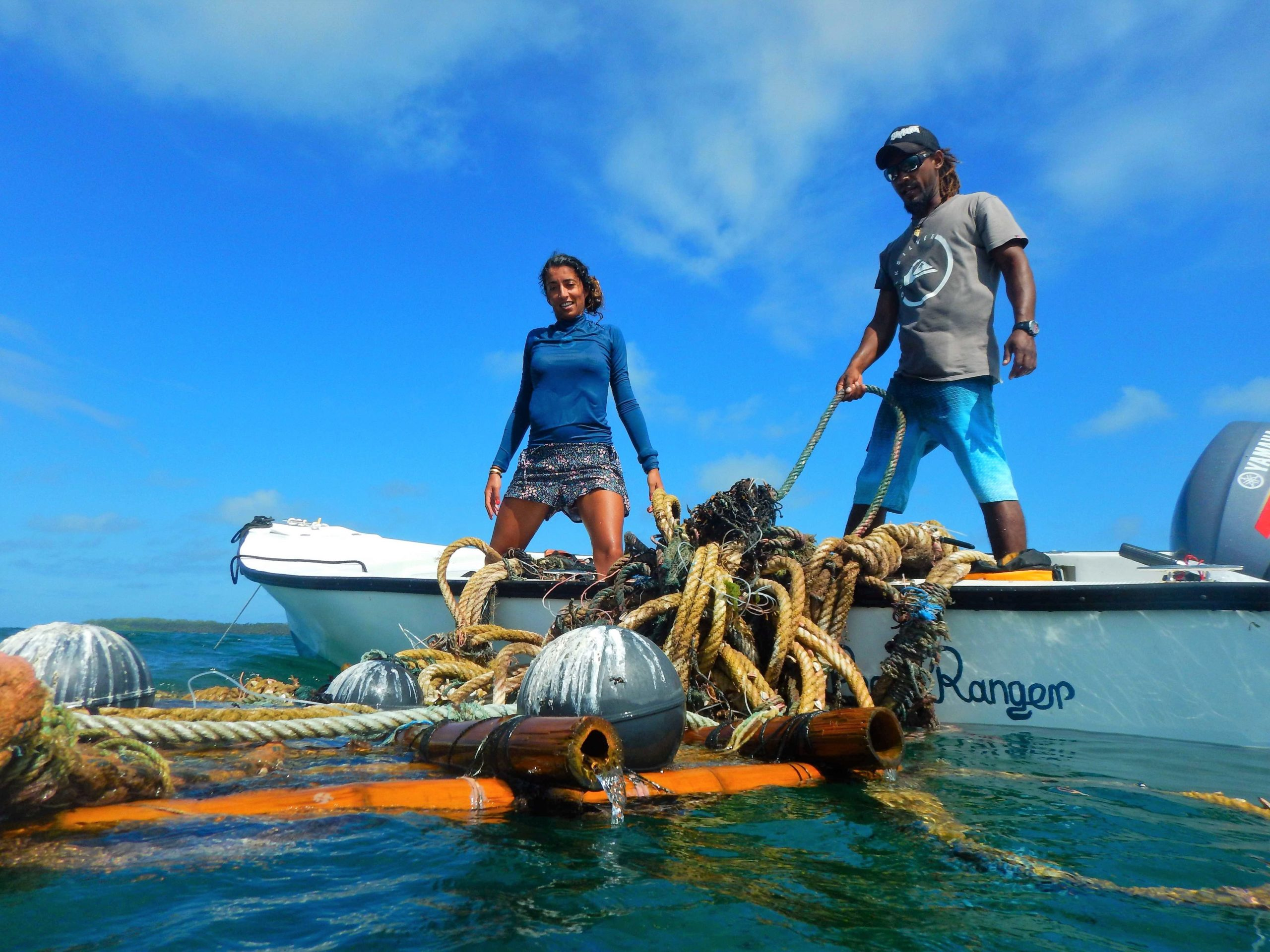 Members of a team from Island Conservation Society removing abandoned FADs near Alphonse Atoll in Seychelles. Image Courtesy of Island Conservation Society.