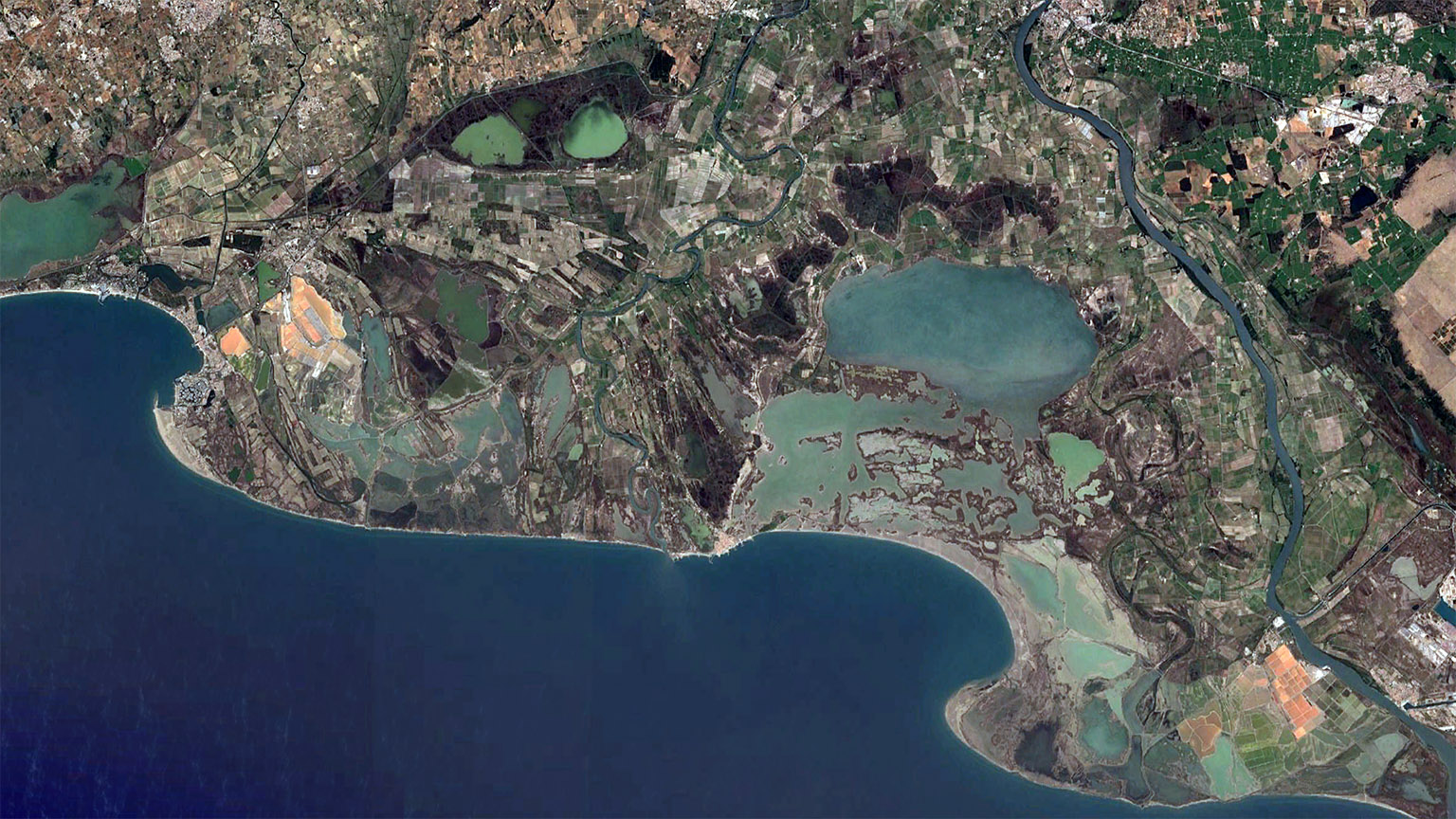 NASA satellite image of brine lagoons and marshes in the Rhone river delta in Camargue.