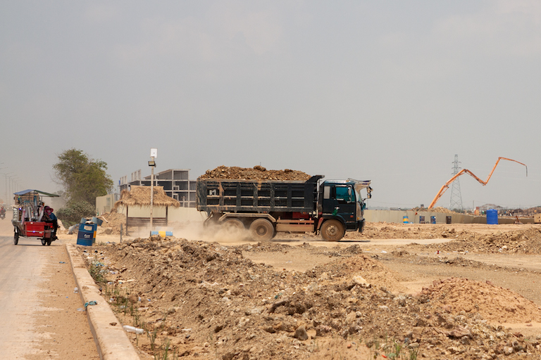 A truck delivering a mix of sand and soil to fill in Boeung Tamok. These trucks now make up the majority of vehicle traffic in the area. Image by Gerald Flynn for Mongabay.