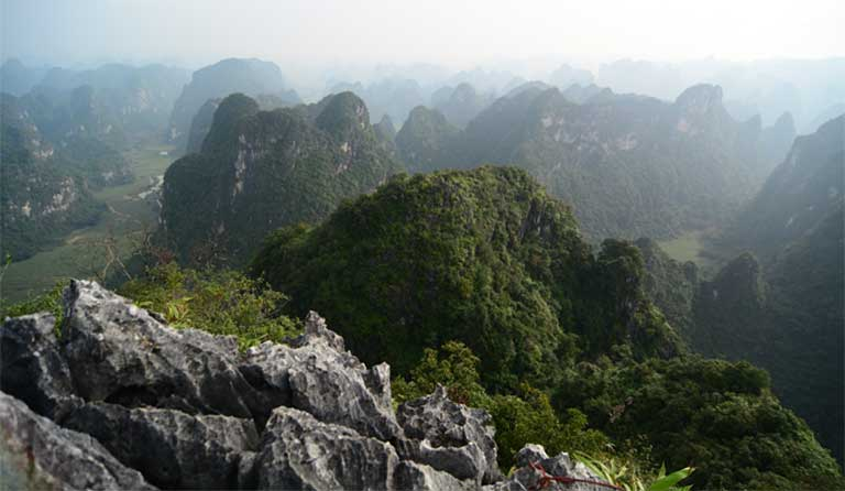 Karst landscape in southern China. Habitats of many species, reptiles included, may be limited to a single karst cave or hill, endangering the species at the moment of its description (and identification of its location) in the scientific literature. Image by Yang Jianhuan.