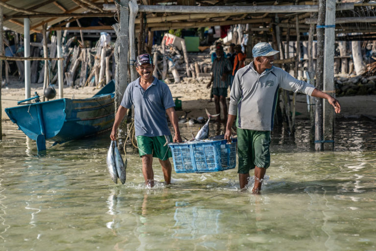 Fishers in Siompu, Southeast Sulawesi with their daily catch. September 2019. Photo credit: Rare.