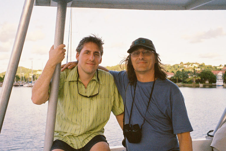 Brett Jenks in St. Lucia with Paul Butler, whose social marketing campaign to save the St. Lucia parrot gave birth to Rare's signature Pride campaigns. Photo credit: Rare