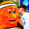 Brett Jenks visits with Mabi, the clown fish mascot of a community Pride campaign in the Philippines in 2011. Photo credit: Rare