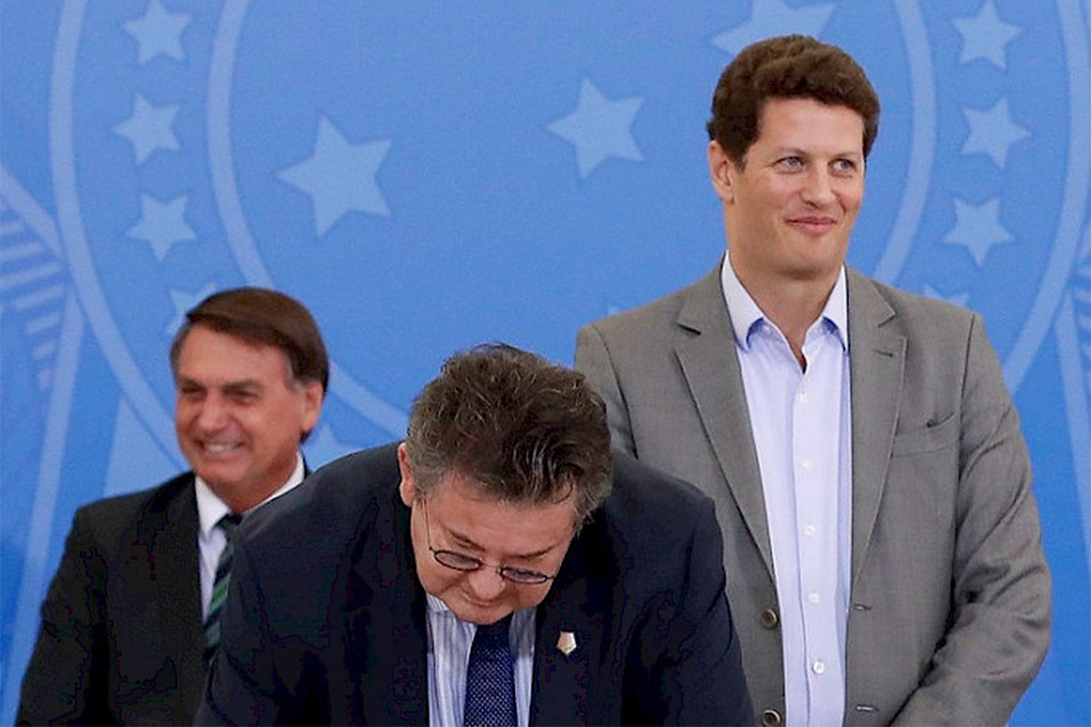 Brazilian President Jair Bolsonaro, Carrefour Latin America president Noel Prioux, and Brazilian Environment Minister Ricardo Salles at the signing of the Adopt-a-Park agreement.