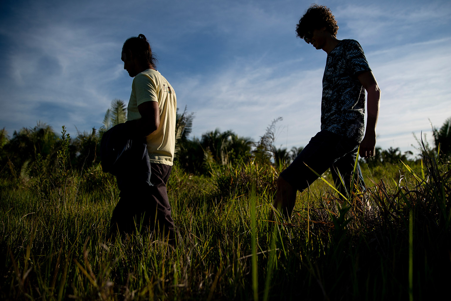 Fernando Araújo walks near the site of a 2017 massacre of rural workers in Pau D'Arco, Brazil with José Vargas, a lawyer for victims of the massacre, on Sunday, June 9, 2019. Fernando survived after hiding in the brush while ten other workers were killed.