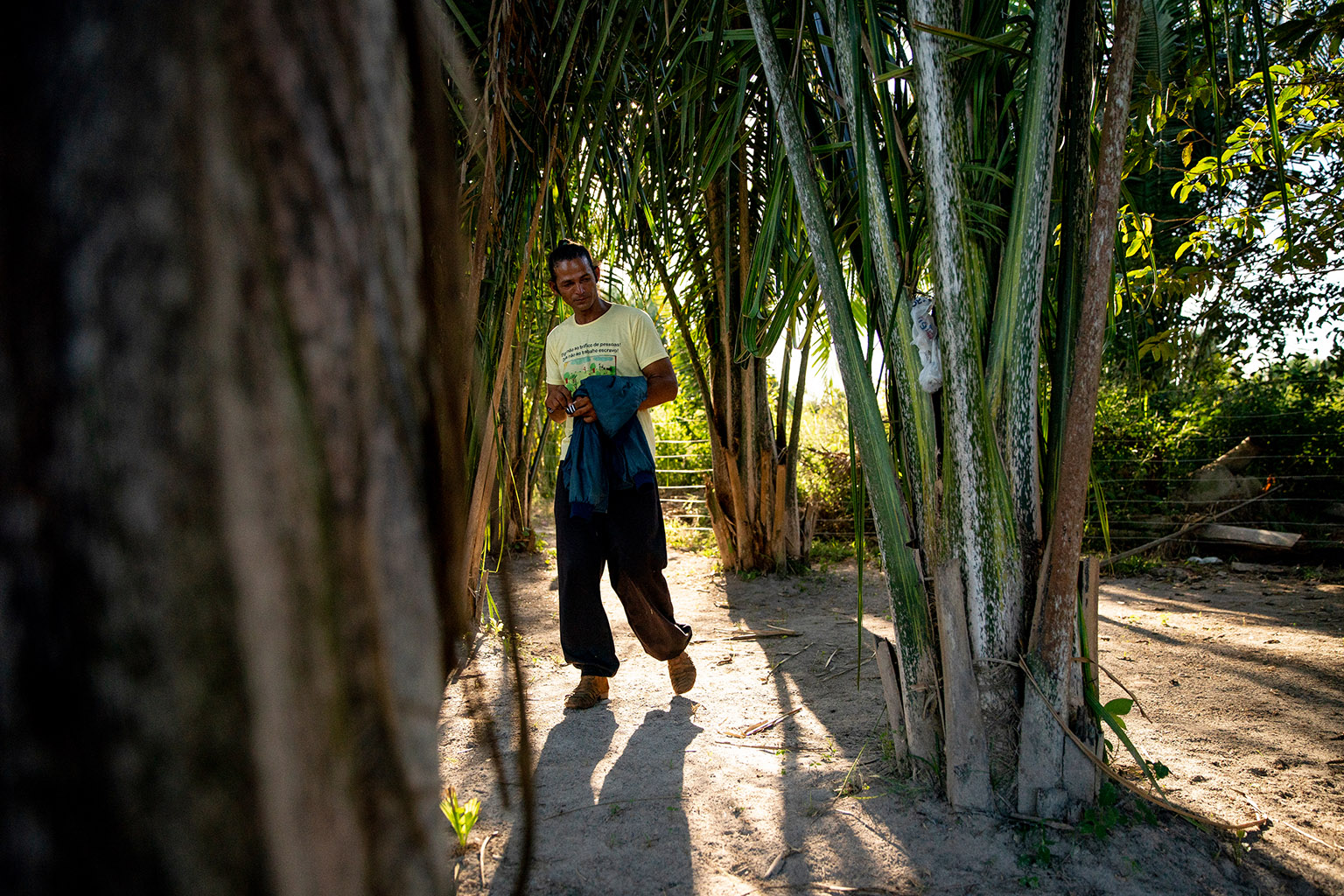 Fernando Araújo walks through the site of a 2017 massacre of rural workers in Pau D'Arco, Brazil on Sunday, June 9, 2019. Fernando survived after hiding in the brush while ten other workers were killed.