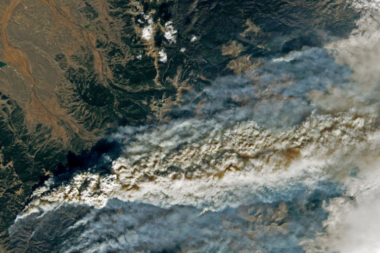 Colorado's East Troublesome Fire, on October 22, 2020, which jumped the Continental Divide and eventually became Colorado's largest fire on record, at nearly 200,000 acres. NASA Earth Observatory images by Lauren Dauphin, using Landsat data from the U.S. Geological Survey.