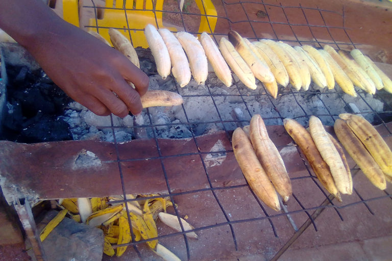 Food vendors roast plantain with a charcoal stove.There are numerous such small vendors in Uganda