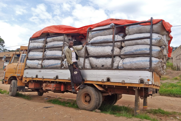 A young man on a truck loaded with charcoal in Nkoko sub-county,Kakumiro district Western Uganda