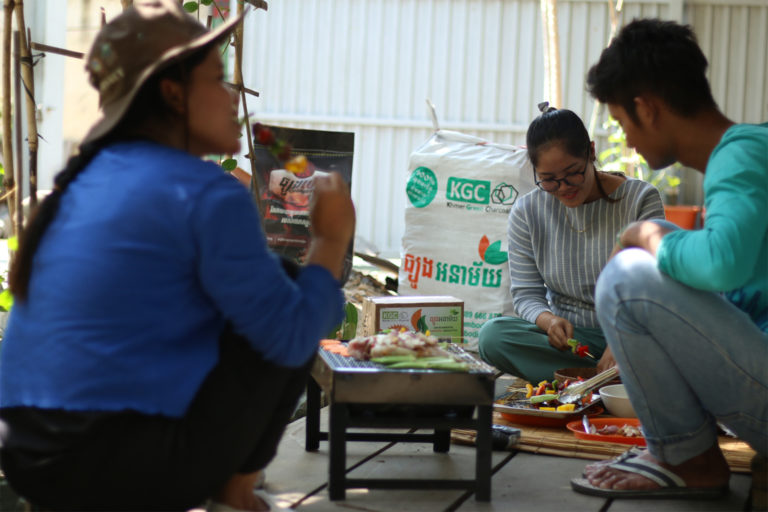 Cambodians enjoying a barbecue with KGC charbriquettes.