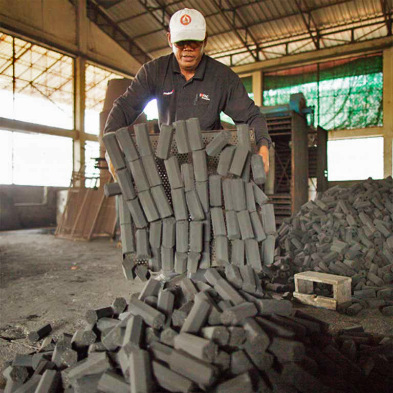 KGC's award-winning, clean-burning coconut husk charbriquettes, hot off the production line.