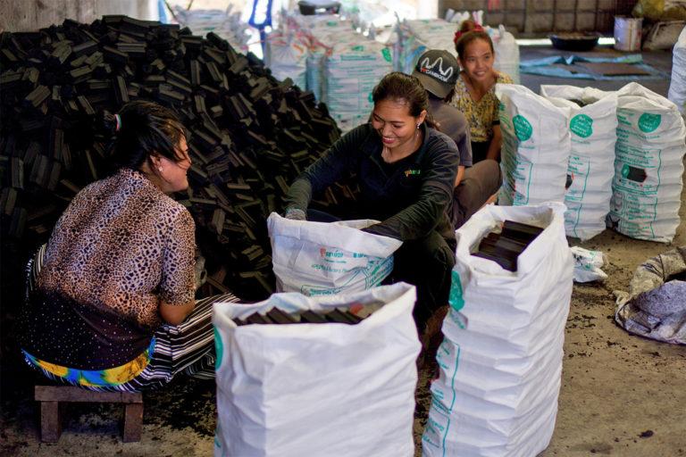 employees pack KGC's charbriquettes