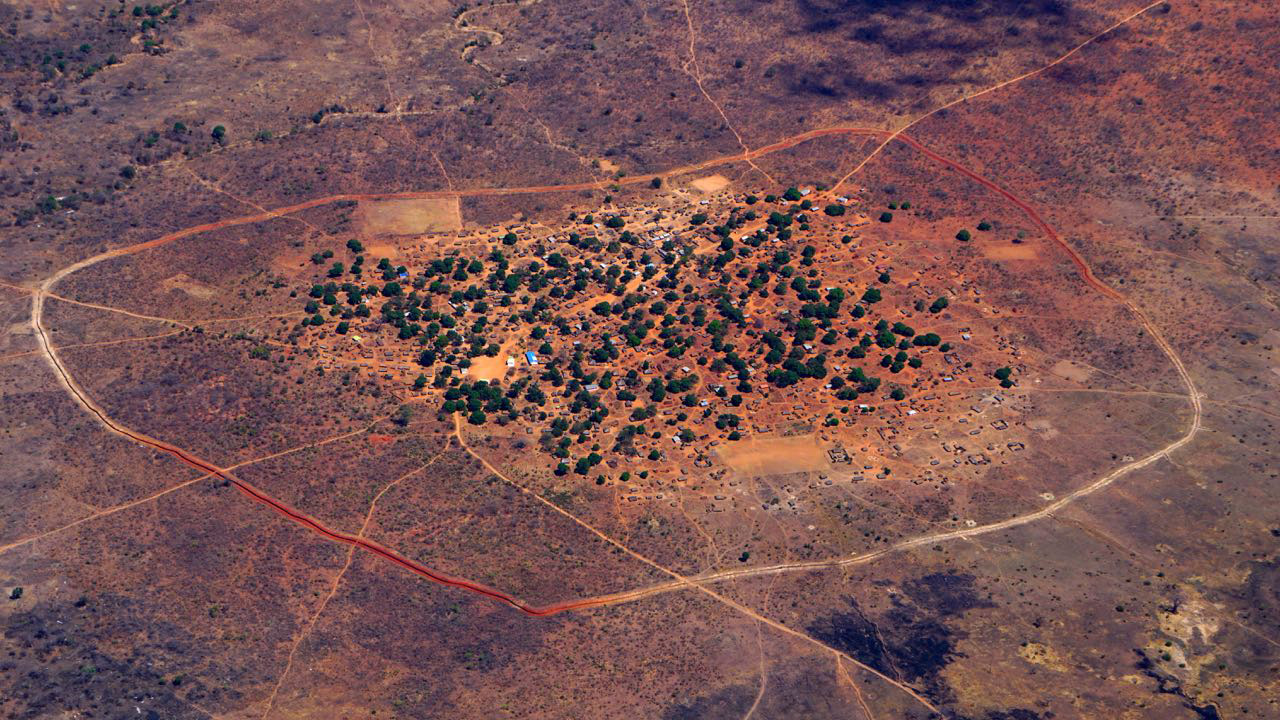Village inside Niassa Special Reserve with elephant trench around it. Photo credit: Colleen Begg