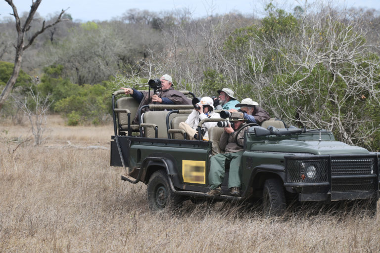 Tourists in South Africa's Kruger National Park photograph wildlife. Image by Rhett Butler for Mongabay.