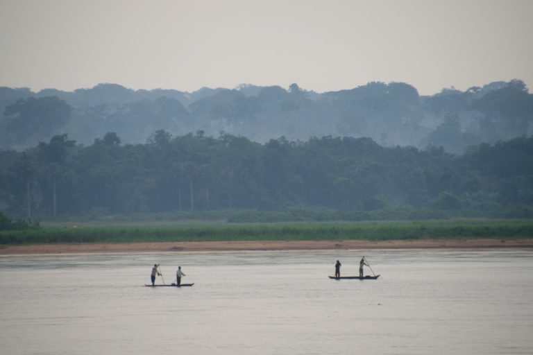 Pirogues on the Kasai River with forests on the far bank. Image by Terese Hart via Flickr.