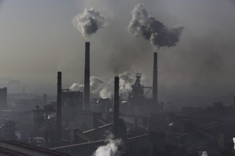 In Hebei province, smoke billows from chimneys from the steel plants in 2014. Photo © Lu Guang / Greenpeace