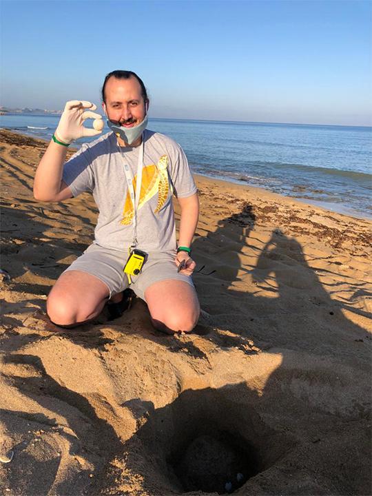 Scientist and conservationist, Ali Badreddine excavates a sea turtle nest on a South Lebanon beach during the 2021 nesting season. Image courtesy of Ali Badreddine.