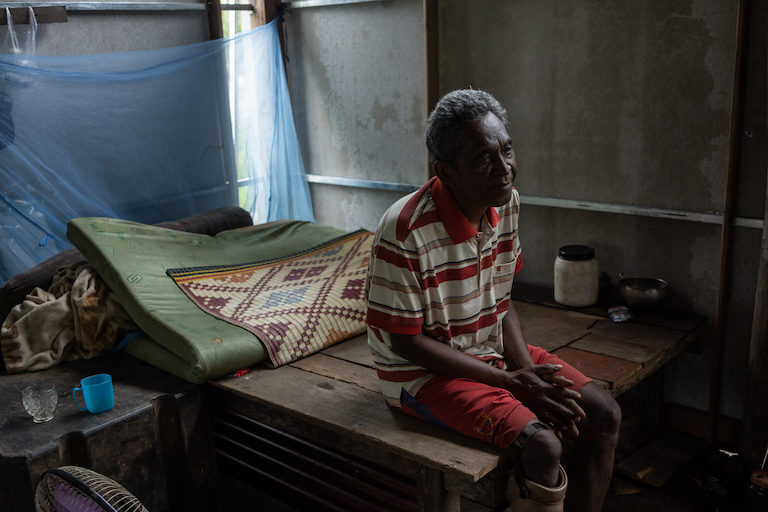Su Phon at his home in Tatai village, Koh Kong province. People from Phnom Penh recently approached him to buy his 1-hectare (2.5-acre) plot of land, for which he has a hard land title. Image by Andy Ball.