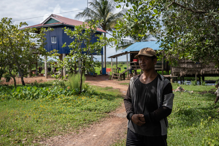 """Kheang Ra at his plot of land in Srae Ambel district that was offered as compensation after a land dispute with Ly Yong Phat, a Cambodian tycoon dubbed the """"King of Koh Kong."""" Three years on, he said he is yet to receive a land title for his plot. Image by Andy Ball."""