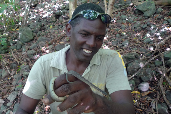 Stephen Lesmond holding one of the world's last Saint Lucia racers. Photo by: T. Ross with DWCT.