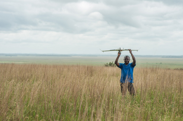 Preparing a drone for flight in Congo's Tchimpounga Nature Reserve. Courtesy of ConservationDrones.org
