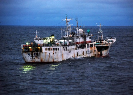 A Taiwanese-flagged fishing vessel suspected of illegal fishing activity, moves through the water before being boarded. Image courtesy of the U.S. Coast Guard/Shawn Eggert