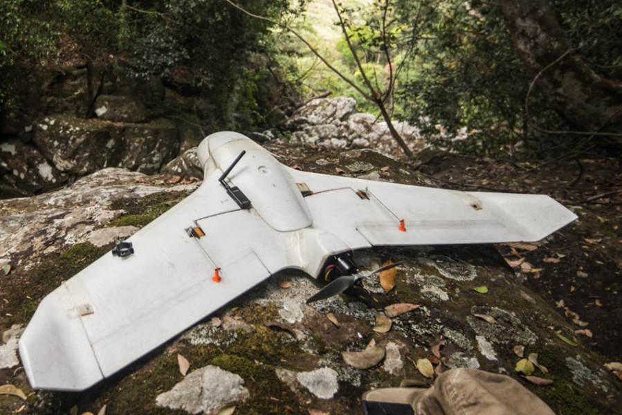 X5 fixed-wing UAV on forest floor