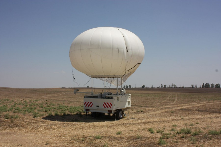 A SkyStar 180 aerostat on a small trailer-based operational station.