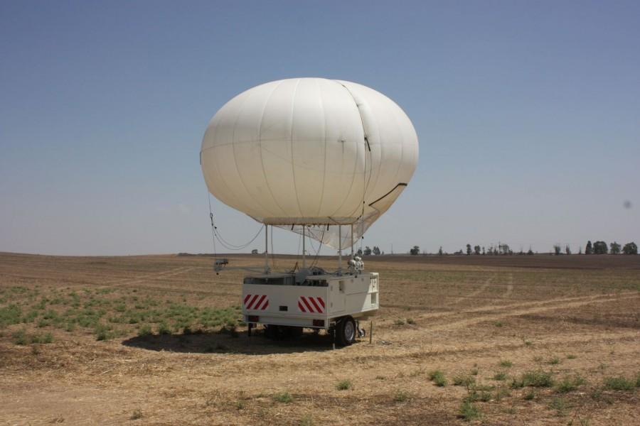 A SkyStar 180 aerostat on a small trailer-based operational station.