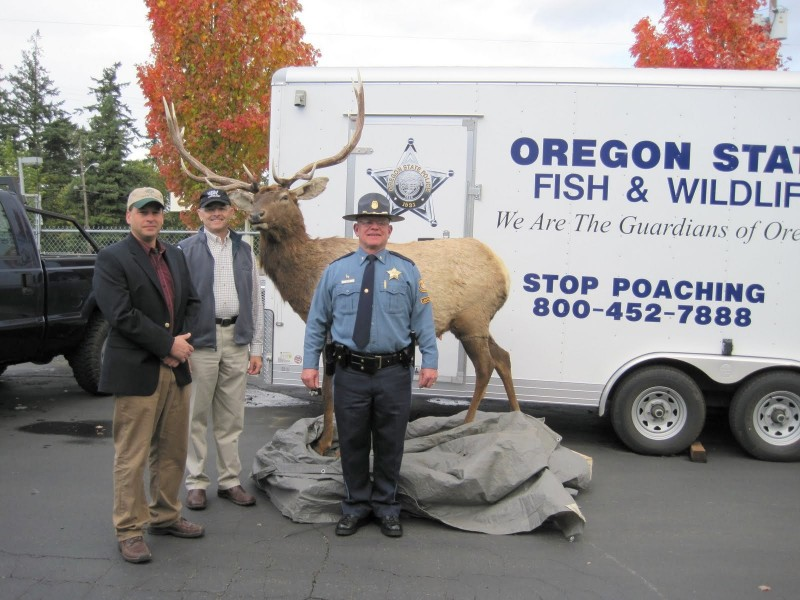 HSWLT's Jim Reed and Bob Koons donate a robotic elk decoy to the Oregon State Fish and Wildlife Department in 2009. Photo credit: HSWLT.