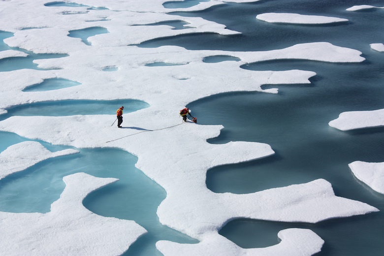 As sea ice atop the Arctic Ocean melts in summer the water can collect in depressions on the surface, forming freshwater ponds, as seen in this photograph from July 2011. Photo credit: NASA / Kathryn Hansen.